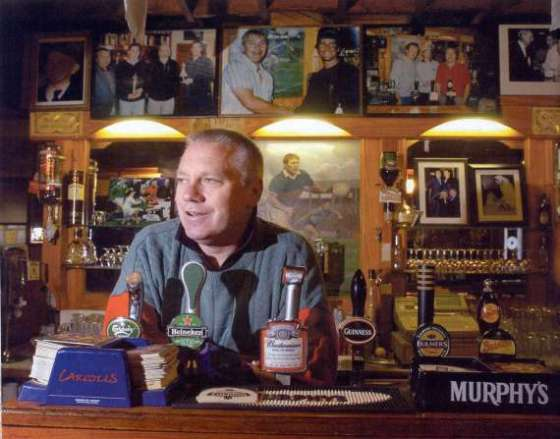 Paidi O'Se behind the bar of his pub in Ventry