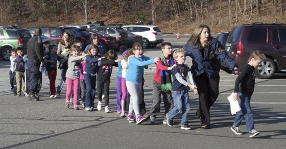 Elementary school children being led to safety following a shooting in their school in Connectict