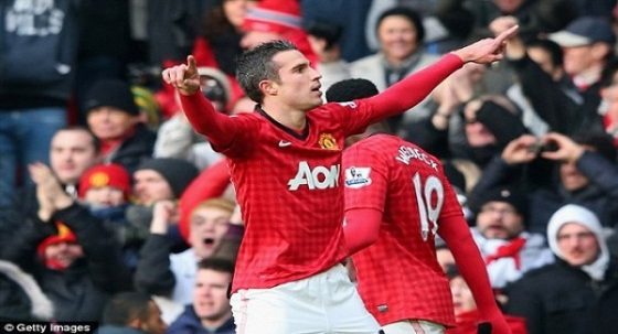 RVP celebrates his opener against Liverpool on Saturday