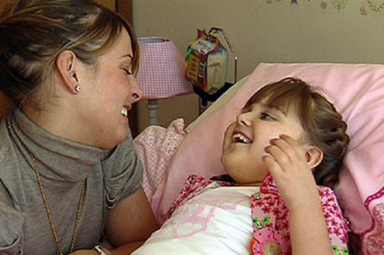 Coleen Rooney at the bedside of Rosie McLoughlin who suffered from Rett Syndrome
